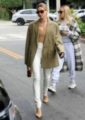 Hailey Bieber looks stylish in green blazer and white pants as she steps out for coffee in West Hollywood, Los Angeles