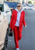 Hailey Bieber looks trendy in a red suit with a hoodie as she steps out in Beverly Hills, Los Angeles