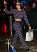 Halsey sports a colorful striped outfit as she arrives at the Z100 Jingle Ball in New York City