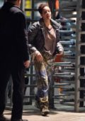Halsey wears tie-dye sweatpants as she and Evan Peters arrive at JFK Airport in New York City