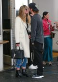 Heidi Klum and Tom Kaulitz pack on some PDA after a meal at E. Baldi in Beverly Hills, California