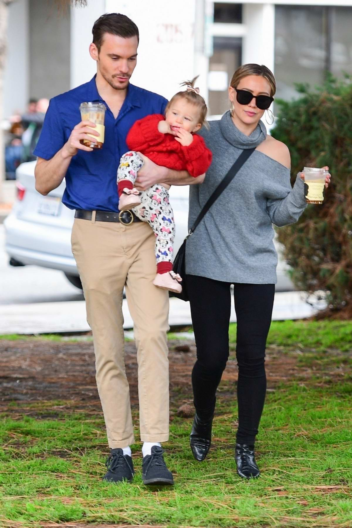 Hilary Duff and Matthew Koma cradle baby Banks during coffee run in Los Angeles