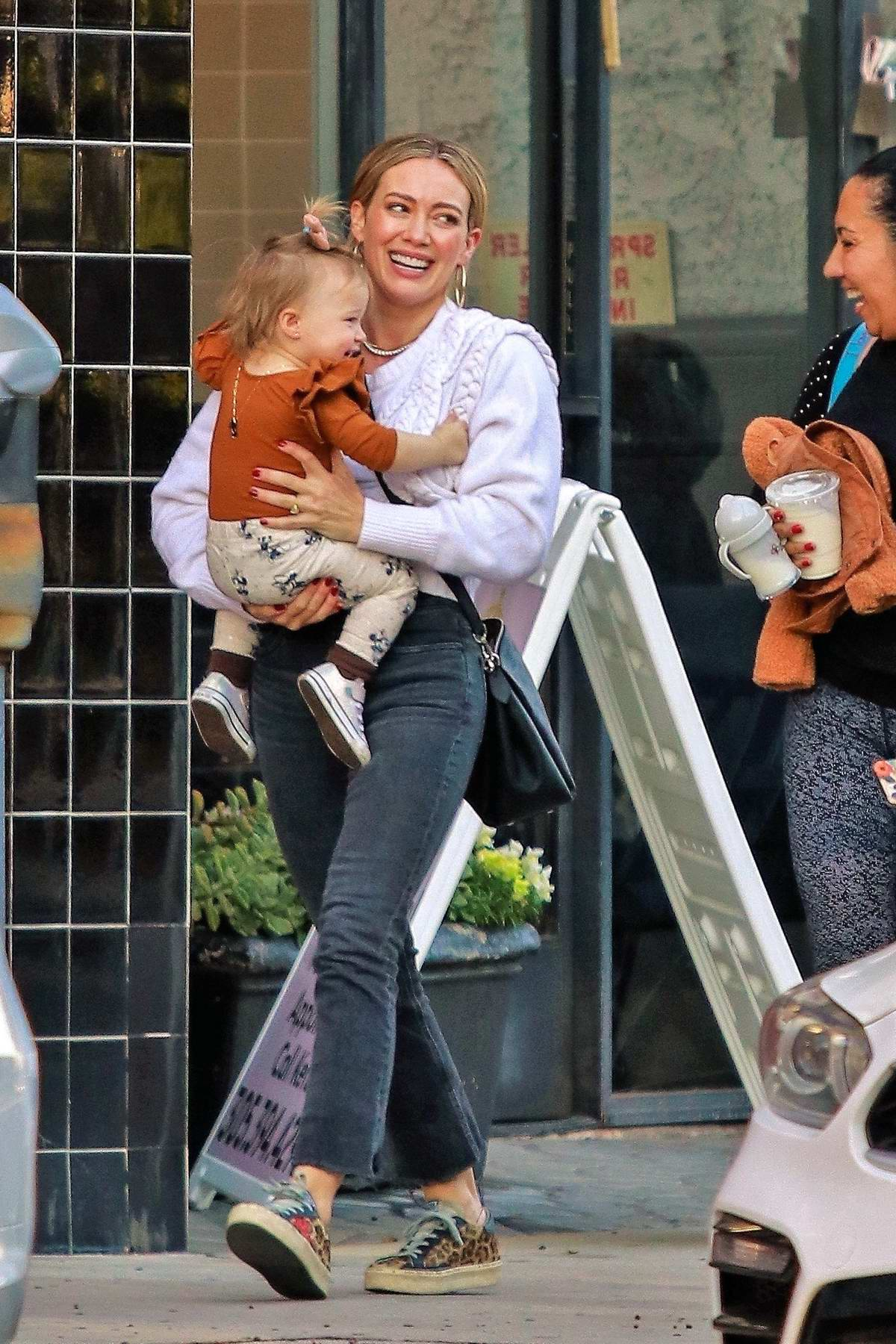 Hilary Duff is all smiles as she carries her adorable daughter Banks in Sherman Oaks, California