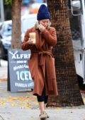 Hilary Duff looks tired as she steps out for her morning coffee with Matthew Koma in Los Angeles