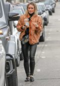 Hilary Duff wears a brown jacket and black leather pants for a coffee run in Studio City, California