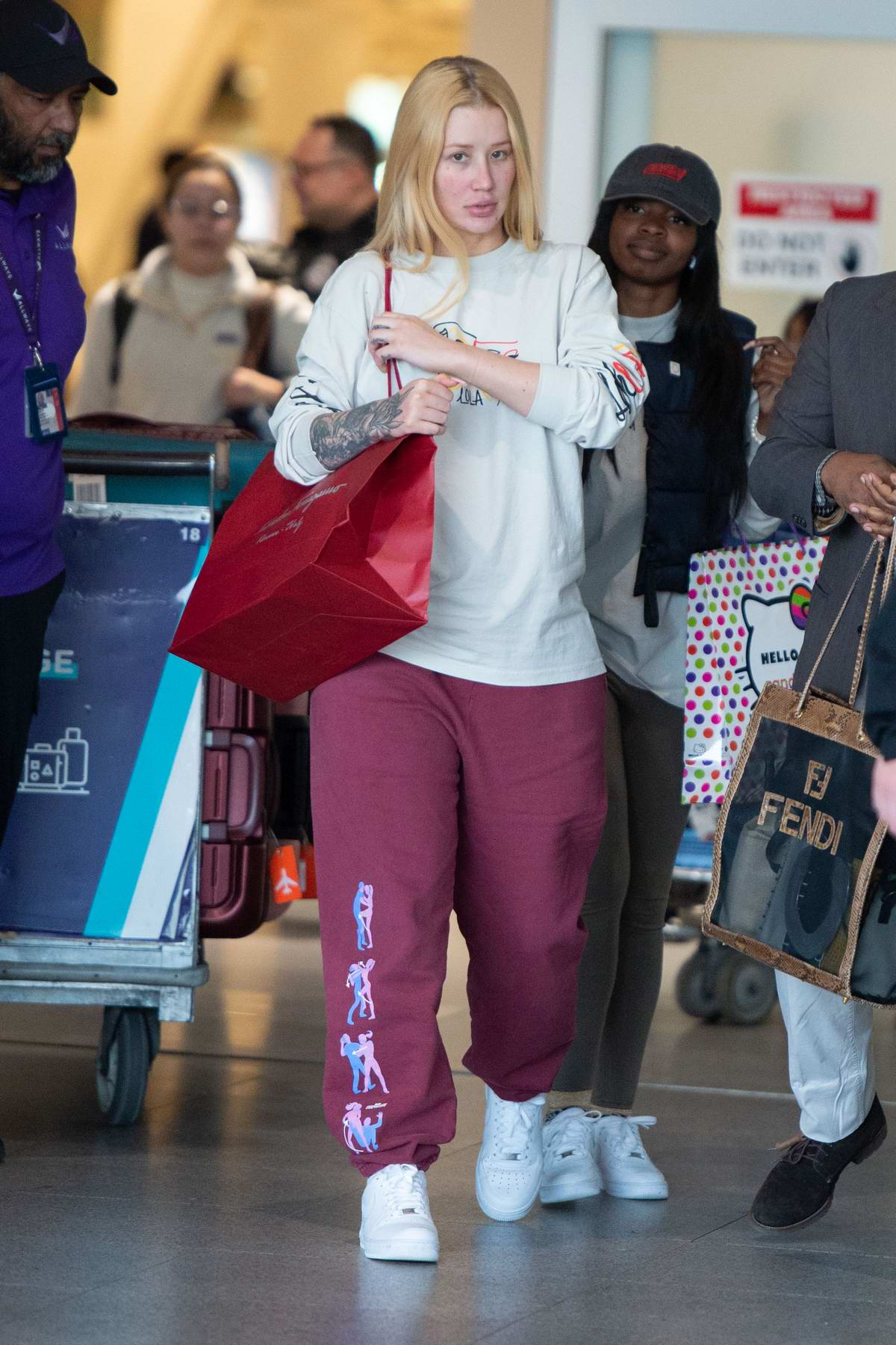Iggy Azalea sports a makeup free casual look as she arrives at JFK Airport in New York City