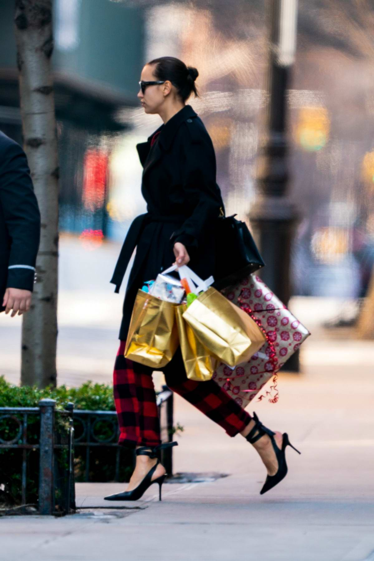 Irina Shayk looks stylish as she steps out on Christmas Day with bags of present in New York City
