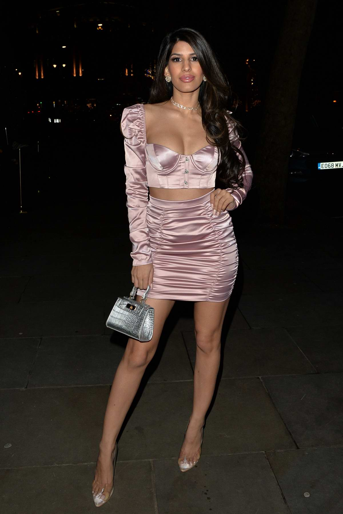 Jasmin Walia seen wearing two-piece light pink mini dress during a night out at Radio bar in London, UK