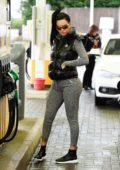 Jemma Lucy stops to fill up her new Lamborghini at a gas station in London, UK