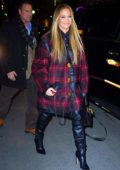 Jennifer Lopez wears a big smile and an oversized flannel coat to the SNL cast dinner in New York City