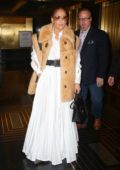 Jennifer Lopez wears a white dress with a beige fur coat while out and about in New York City