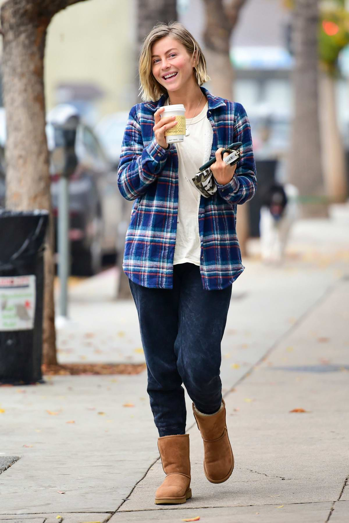 Julianne Hough looks cozy in a flannel shirt, sweatpants and UGG boots while making a coffee run in Studio City, California