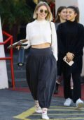 Julianne Hough shows off her toned abs in a white crop top as she leaves a dance studio in Los Angeles