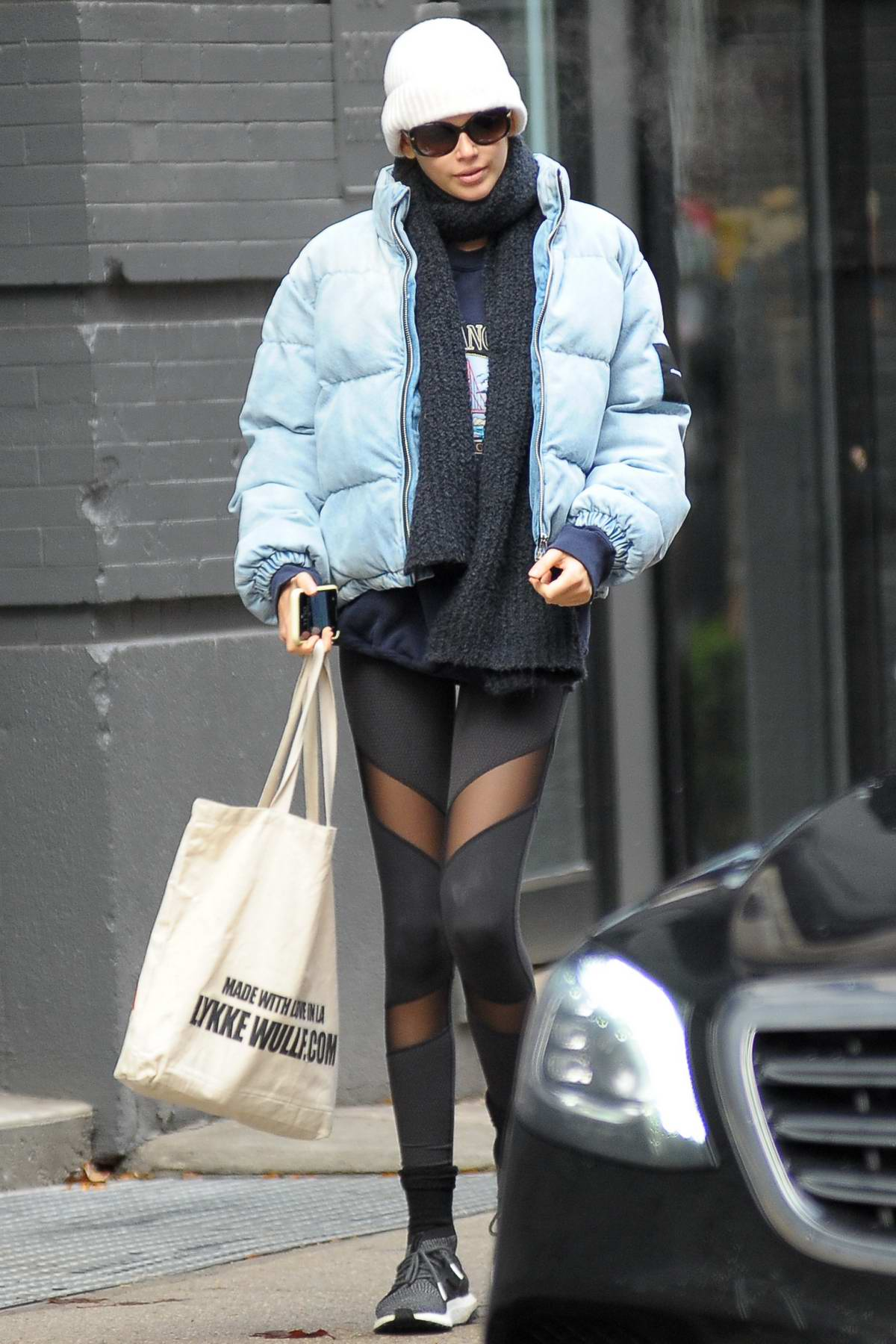 Kaia Gerber bundles up in a blue puffer jacket and leggings as she steps out for coffee in New York City