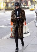 Kaia Gerber keeps it cozy in a leopard print fur coat as she takes a morning walk around SoHo in New York City