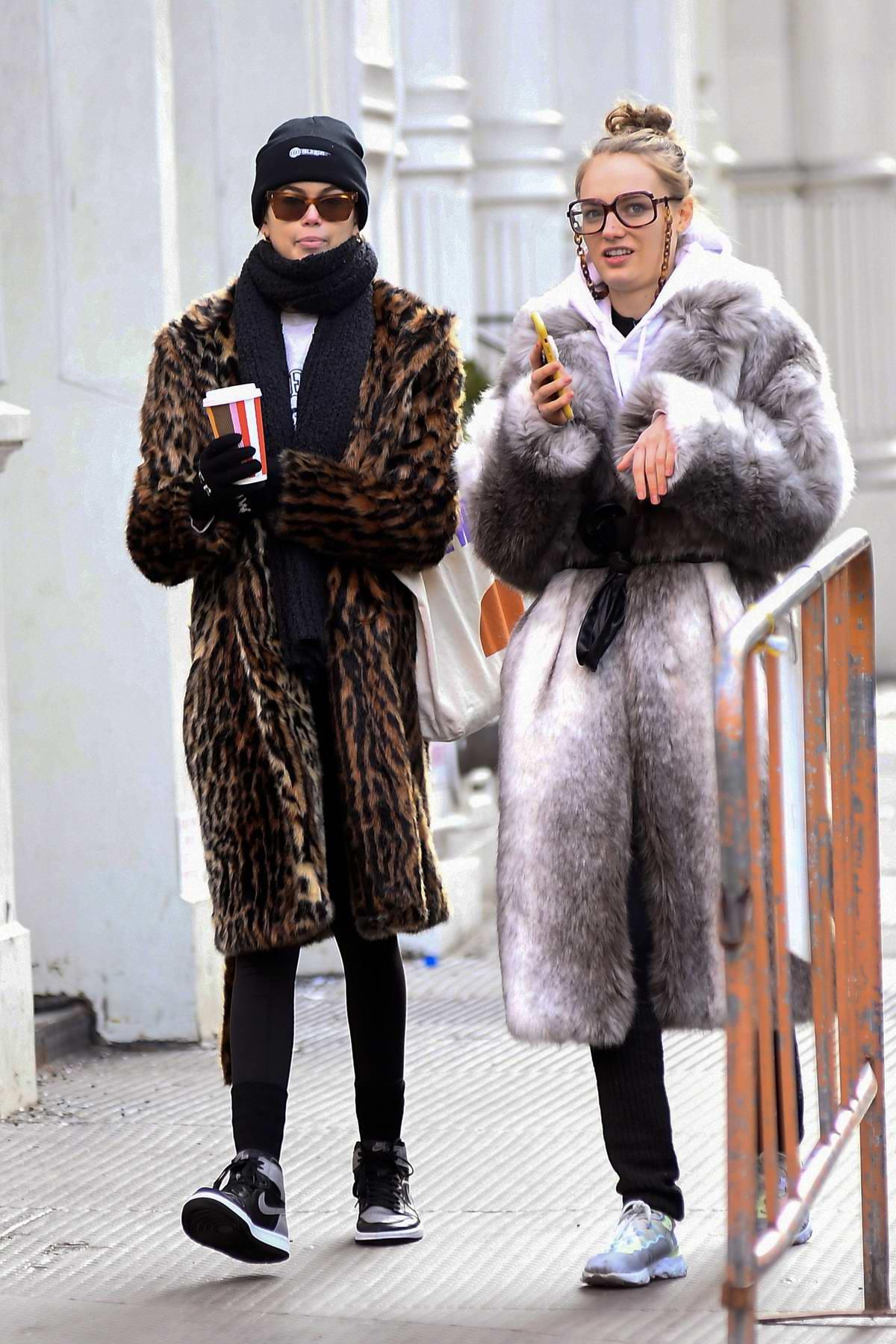 kaia gerber keeps it cozy in a leopard print fur coat as ...