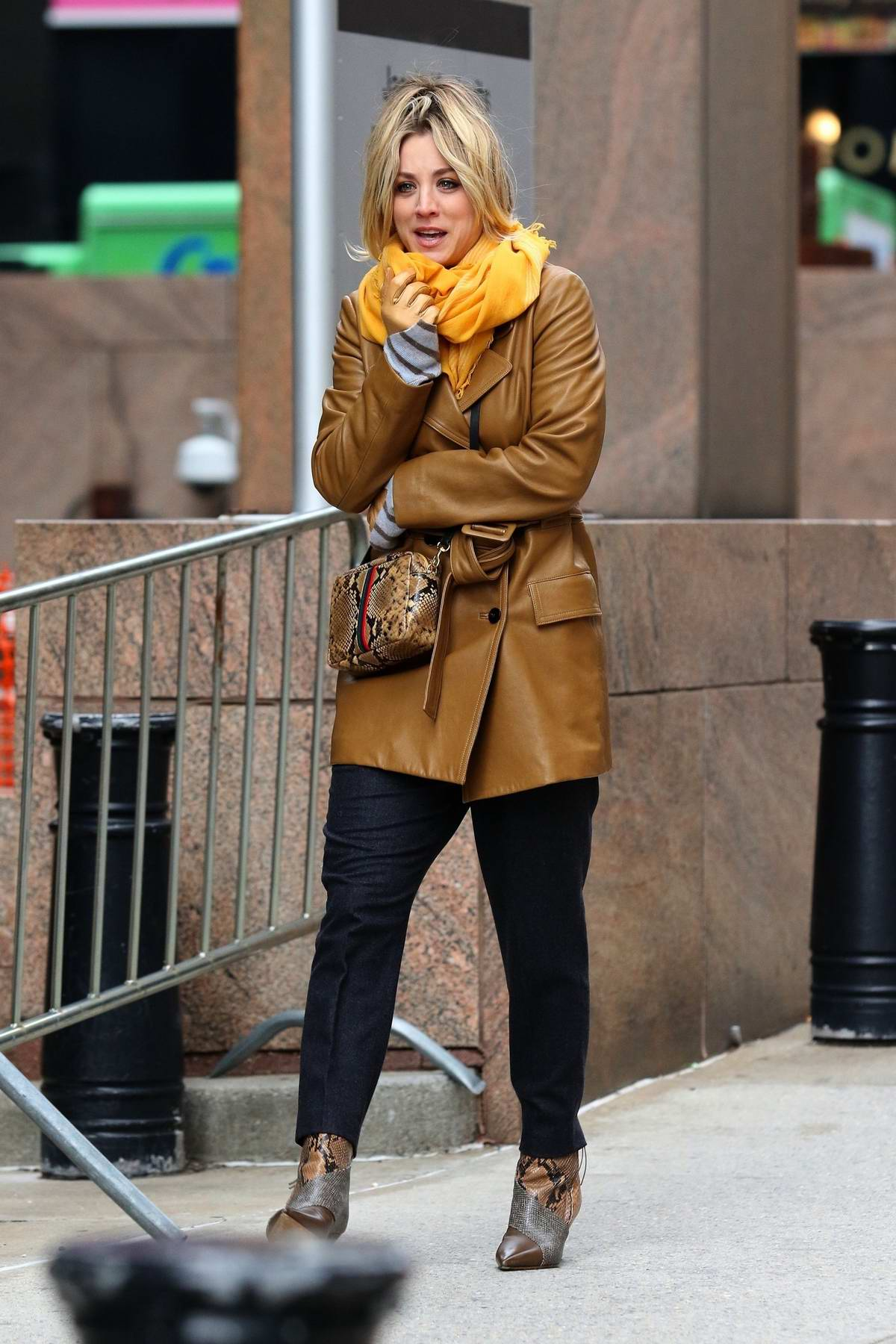 Kaley Cuoco braves the windy weather while on the set of 'The Flight Attendant' in New York City