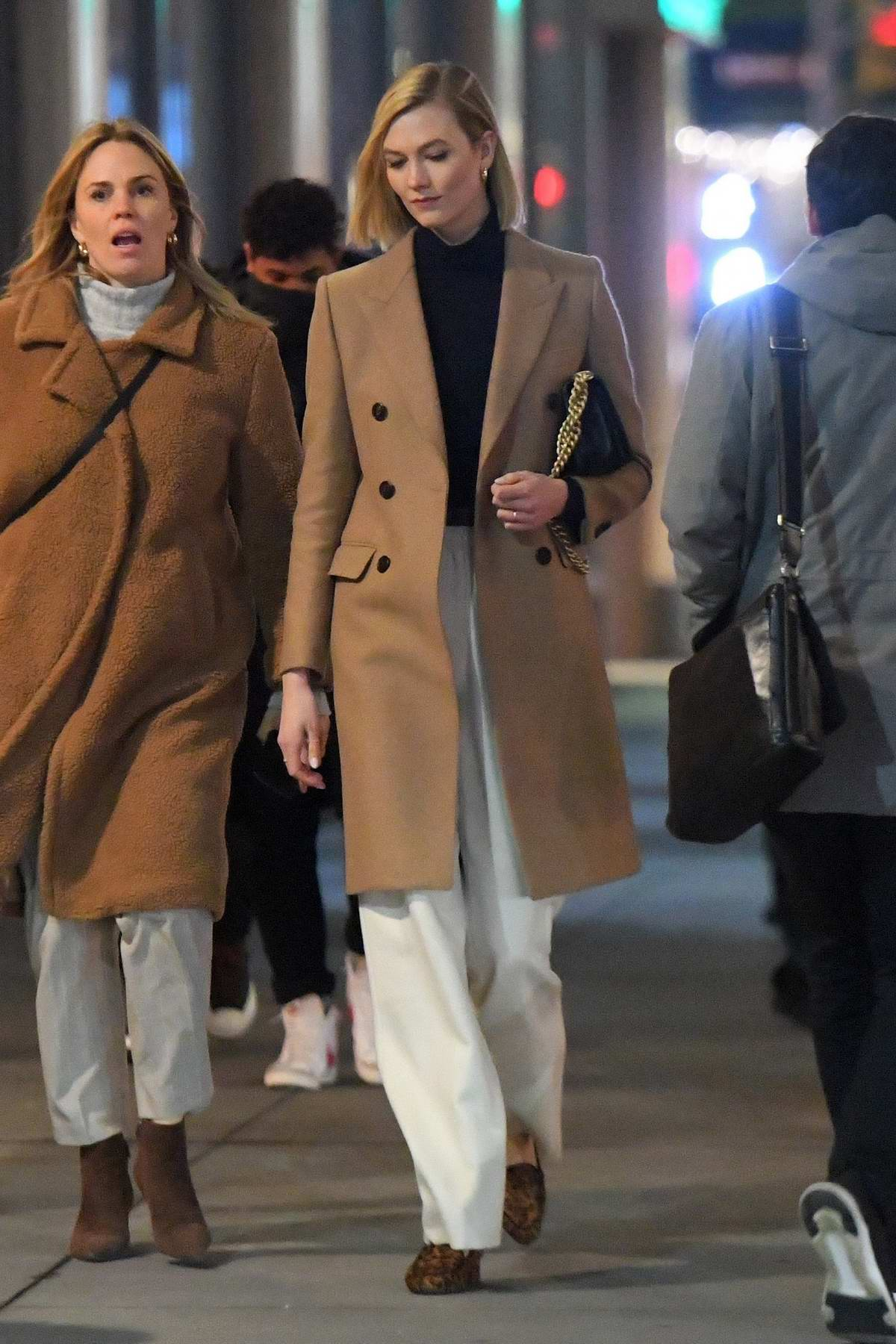 Karlie Kloss looks chic as she steps out for stroll with friends in New York City