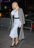 Karlie Kloss looks chic in a light blue dress while stepping out in New York City