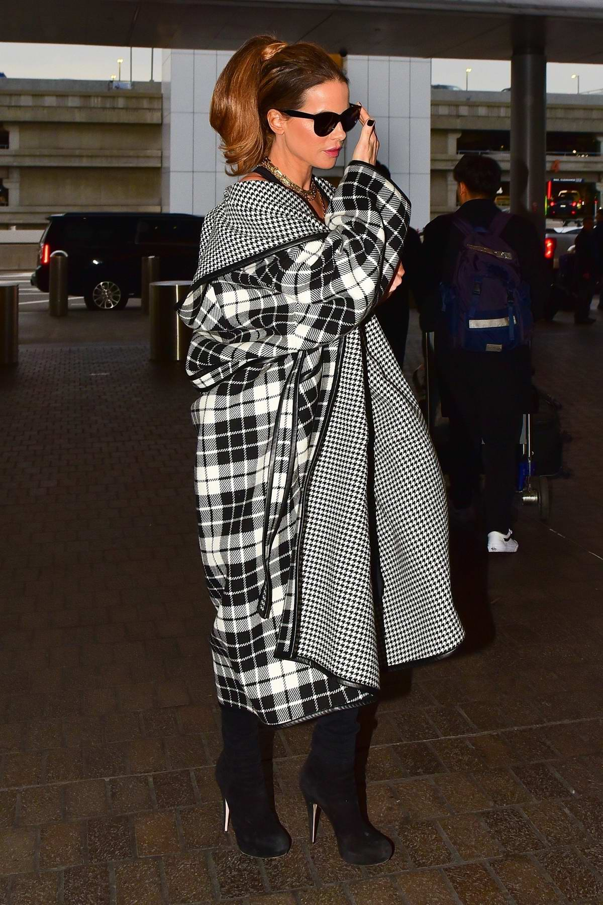 Kate Beckinsale looks stylish in monochrome plaid outfit as she arrives for a flight to London at LAX airport in Los Angeles