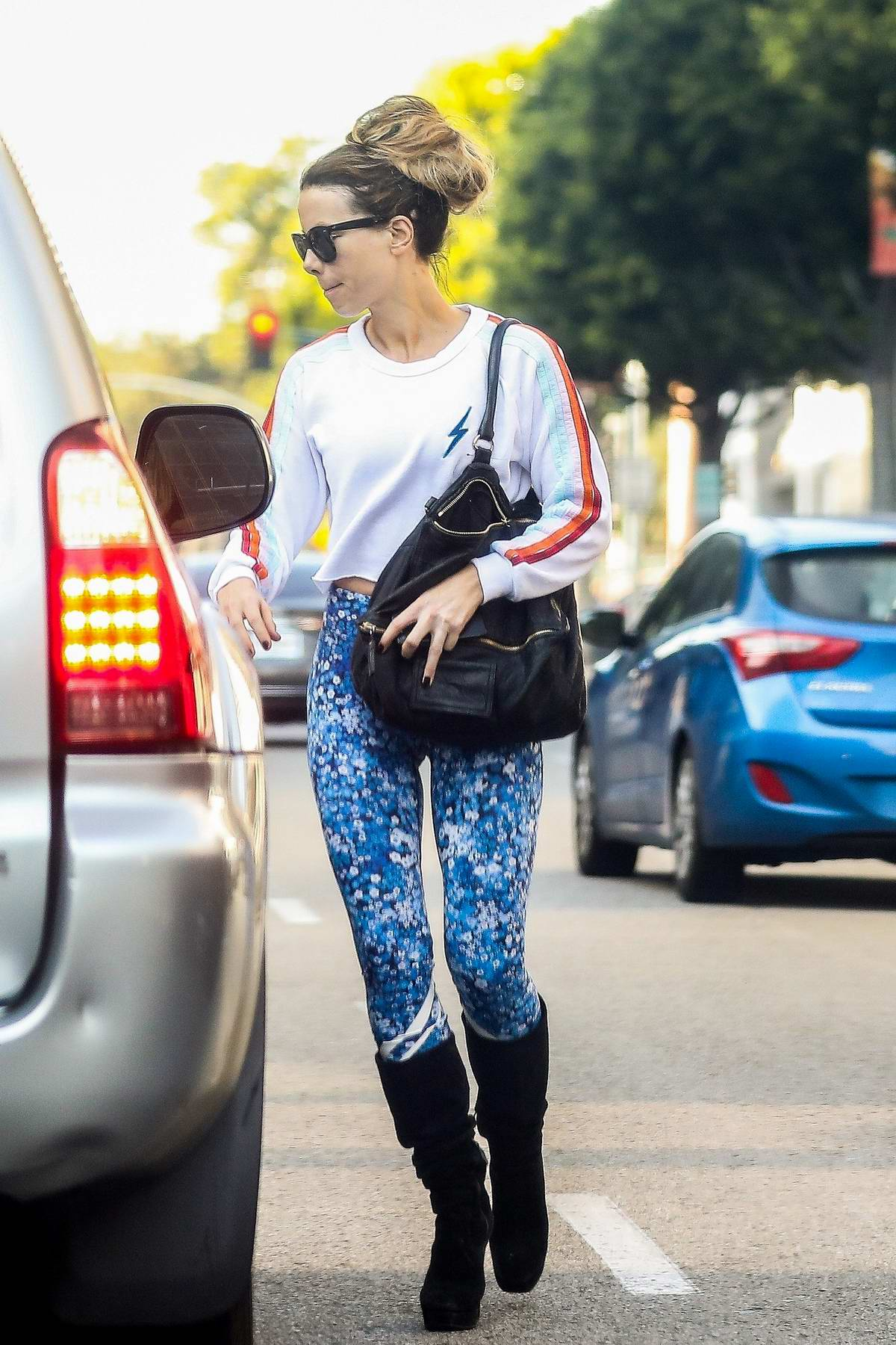 Kate Beckinsale rocks blue leggings with a white crop top while visiting a nail salon in Beverly Hills, California
