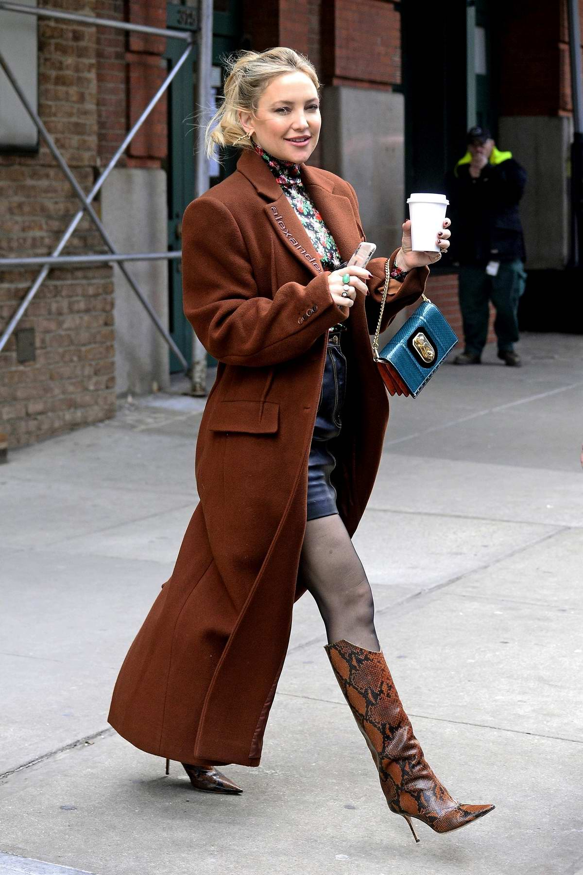 Kate Hudson looks stunning in a brown Alexander Wang overcoat paired with a floral top, leather skirt and snakeskin boots as she leaves the Greenwich hotel in New York City