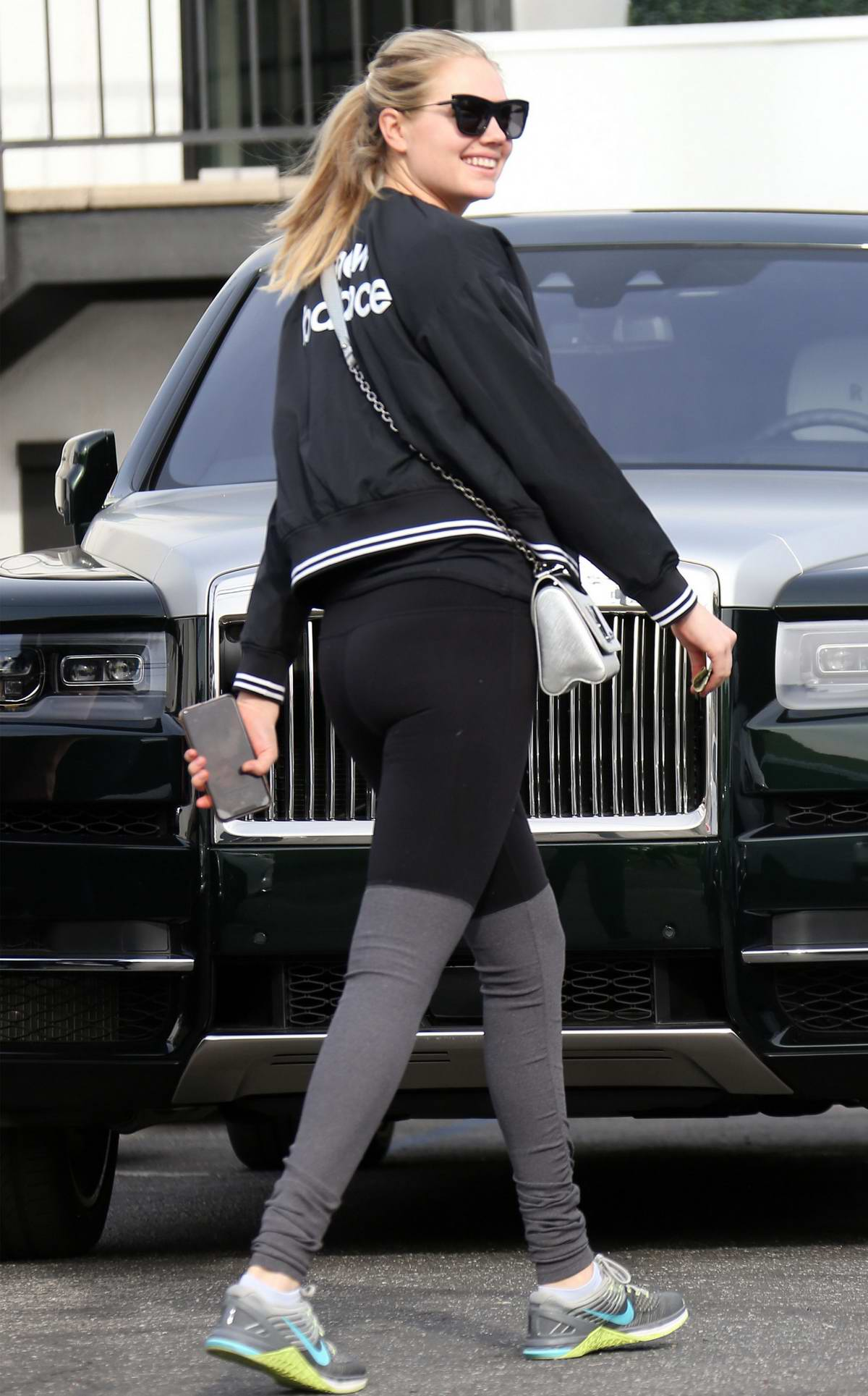 Kate Upton rocks 'New Balance' jacket and two-toned leggings while out on her Rolls-Royce in Beverly Hills, California