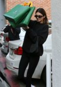 Kendall Jenner sports a black sweatshirt with matching leggings while shopping at Goyard in Beverly Hills, Los Angeles