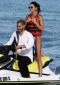 Kendall Jenner sports a snakeskin print bikini as she enjoys some jet ski rides with Fai Khadra in Miami, Florida