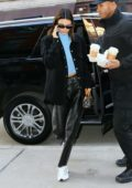Kendall Jenner wears a black jacket with a blue turtleneck and black leather pants as she steps out for lunch in New York City