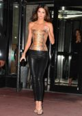 Kendall Jenner wears a snakeskin top and black leather pants while out for dinner with friends at Milos in Miami Beach, Florida