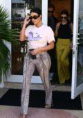 Kim Kardashian shows off her curves as she steps out for shopping with Kourtney Kardashian in Miami, Florida