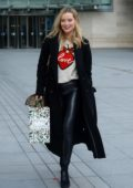 Laura Whitmroe seen wearing a black long coat with black leather pants as she leaves BBC Radio 5 in London,UK