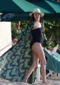 Lauren Silverman wears a black swimsuit as she enjoys a beach day in Barbados