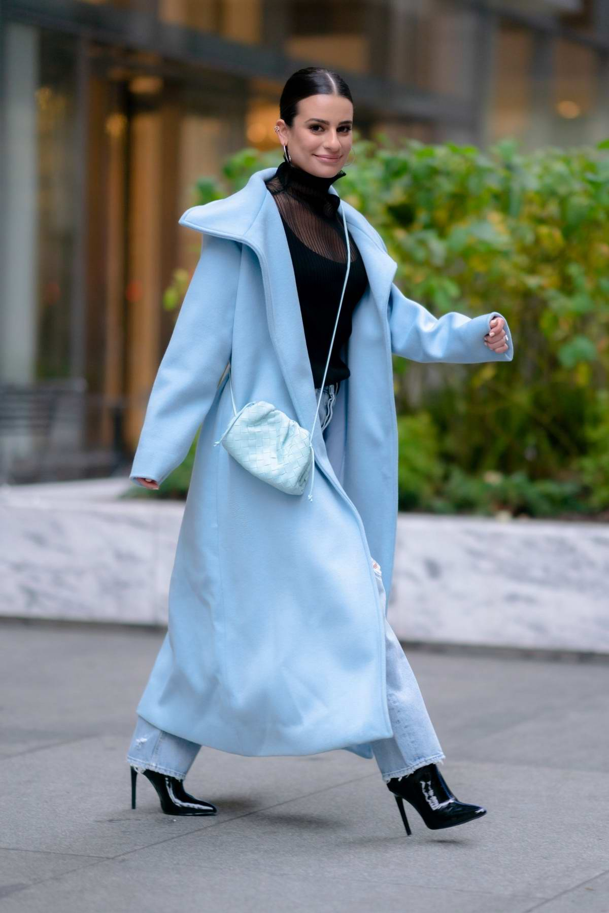 Lea Michele looks stylish in an ice blue long coat with a black top and jeans while out in Midtown, New York City