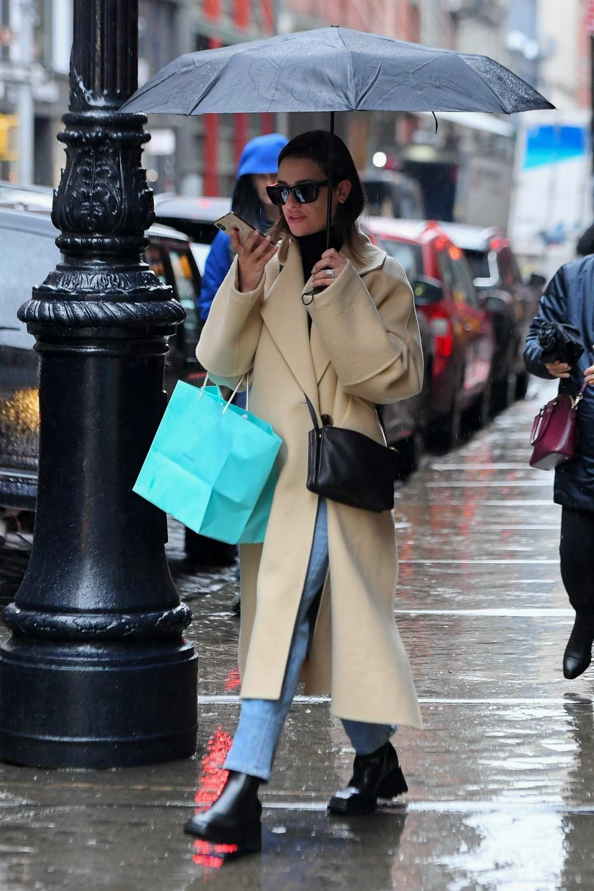 Lea Michele waits for her Uber after shopping with her mother in New York City