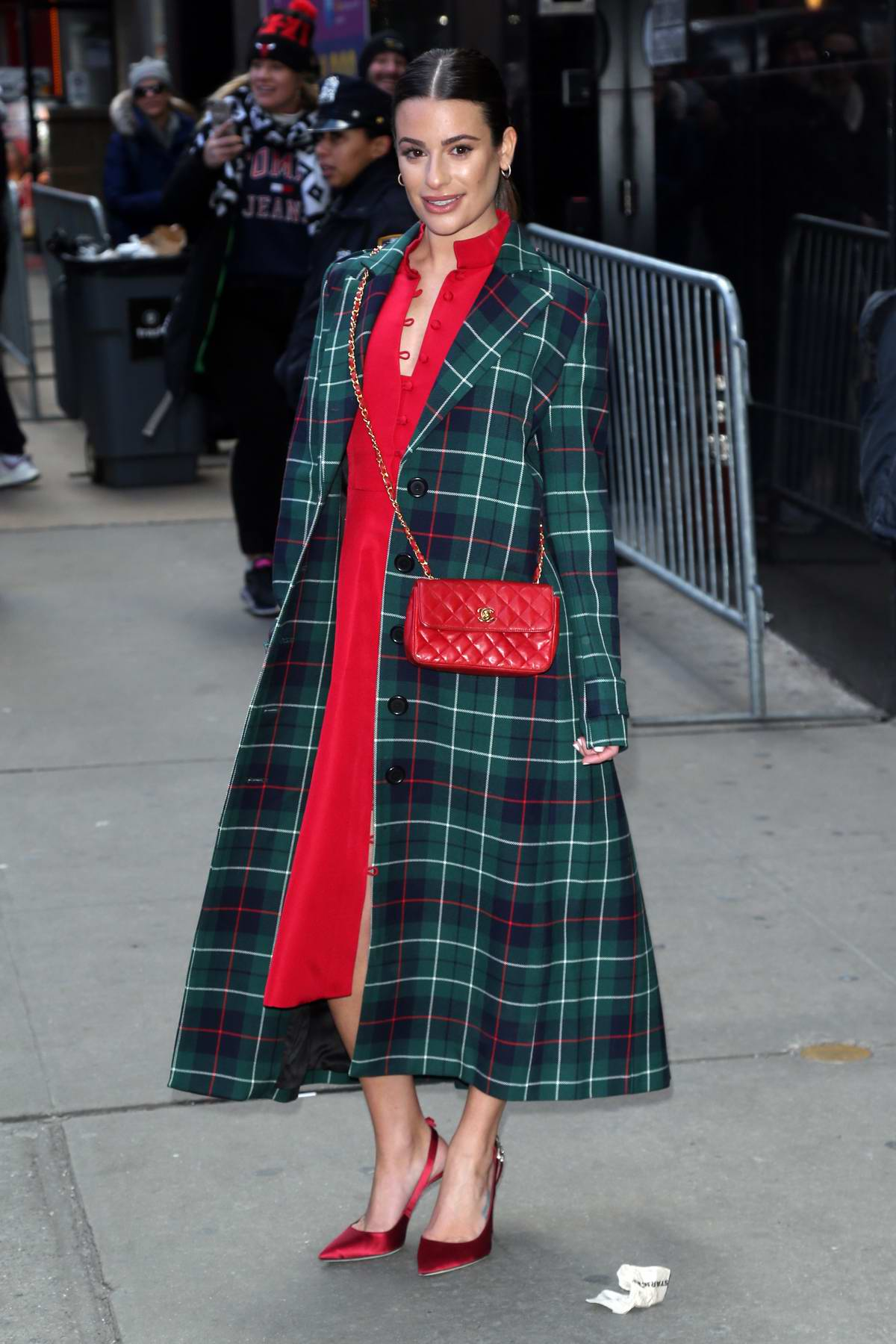 Lea Michele wears a red dress with plaid trench coat as she visits 'Good Morning America' in New York City