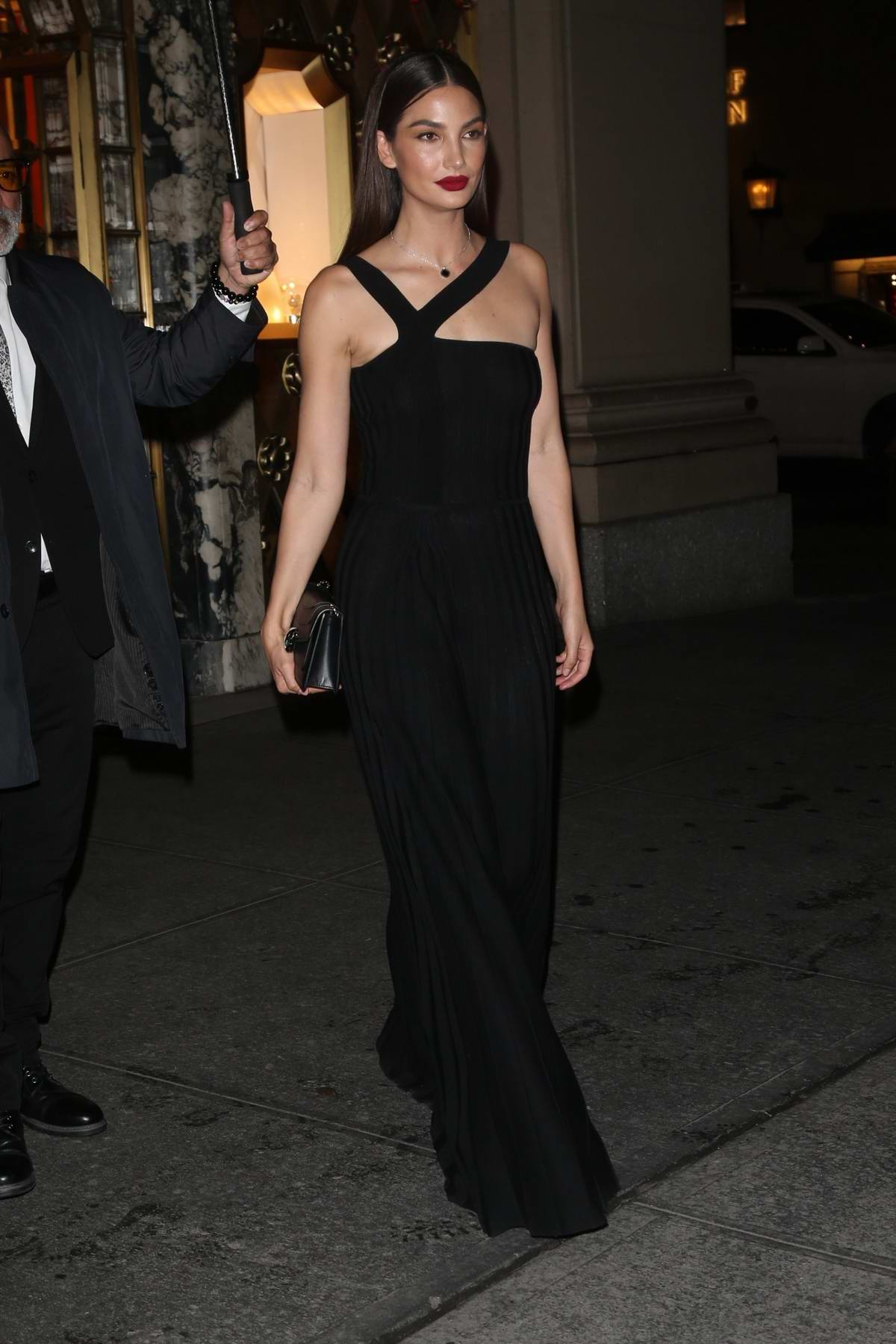 Lily Aldridge looks elegant in a black gown as she leaves a Bulgari event in New York City