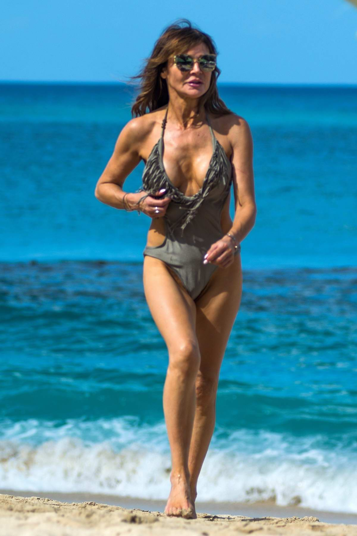 Lizzie Cundy enjoys a walk on the beach during a winter break in Barbados
