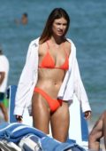 Lorena Rae sports a bright orange bikini as she hits the beach with friends in Miami Beach, Florida