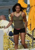 Lourdes Leon seen wearing a yellow bikini while relaxing poolside in Miami, Florida
