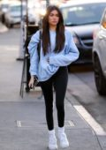 Madison Beer sports a light blue sweatshirt and black leggings while visiting a salon in West Hollywood, Los Angeles