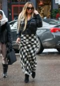 Mariah Carey wears a black puffy jacket with checkered skirt while out shopping in Aspen, Colorado
