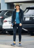 Megan Fox rocks a blue top with black jacket and leggings as she hits the gym in Woodland Hills, California