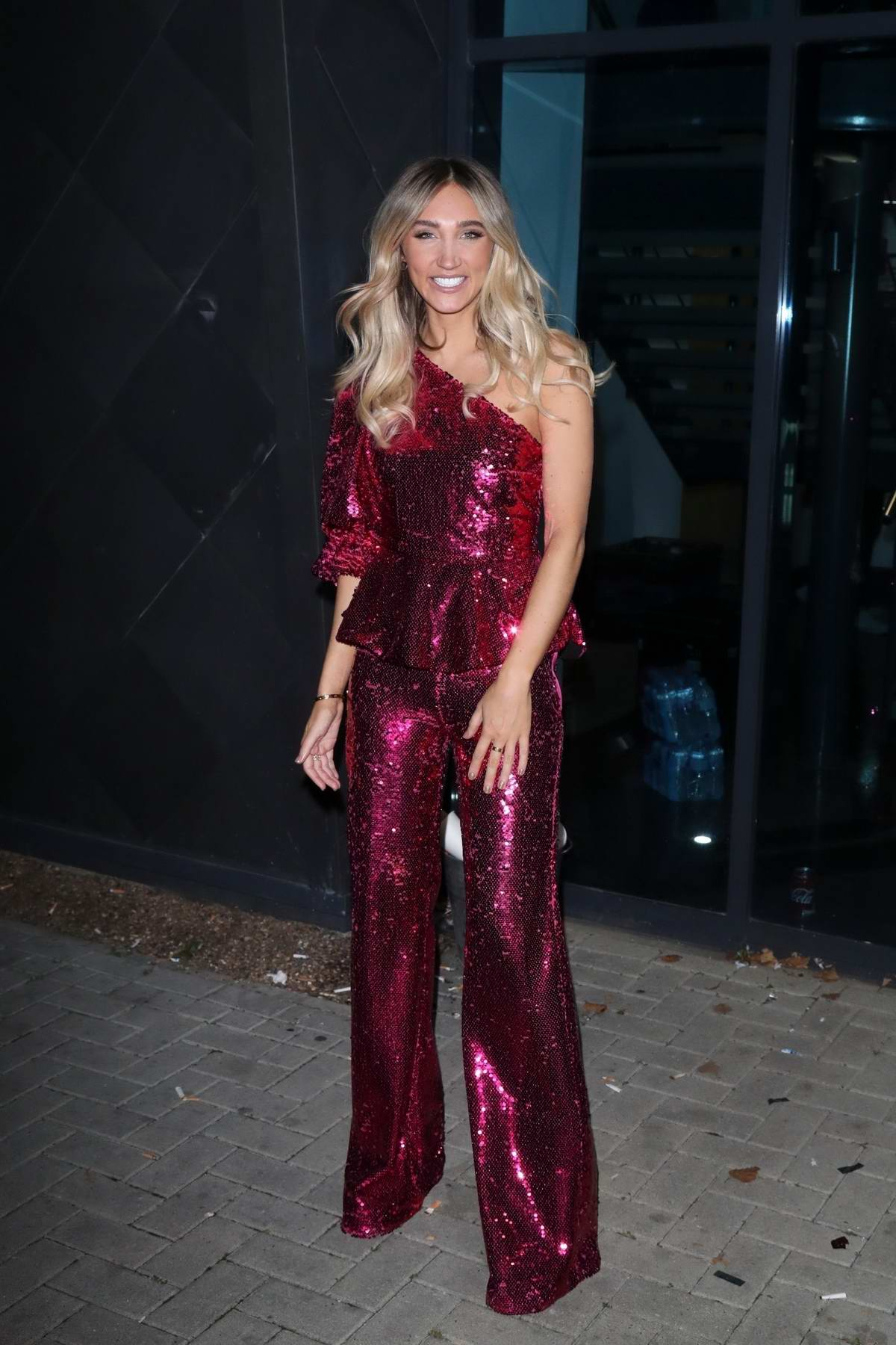 Megan McKenna dazzles in a sparkly maroon outfit as she leaves X Factor Studio in London, UK
