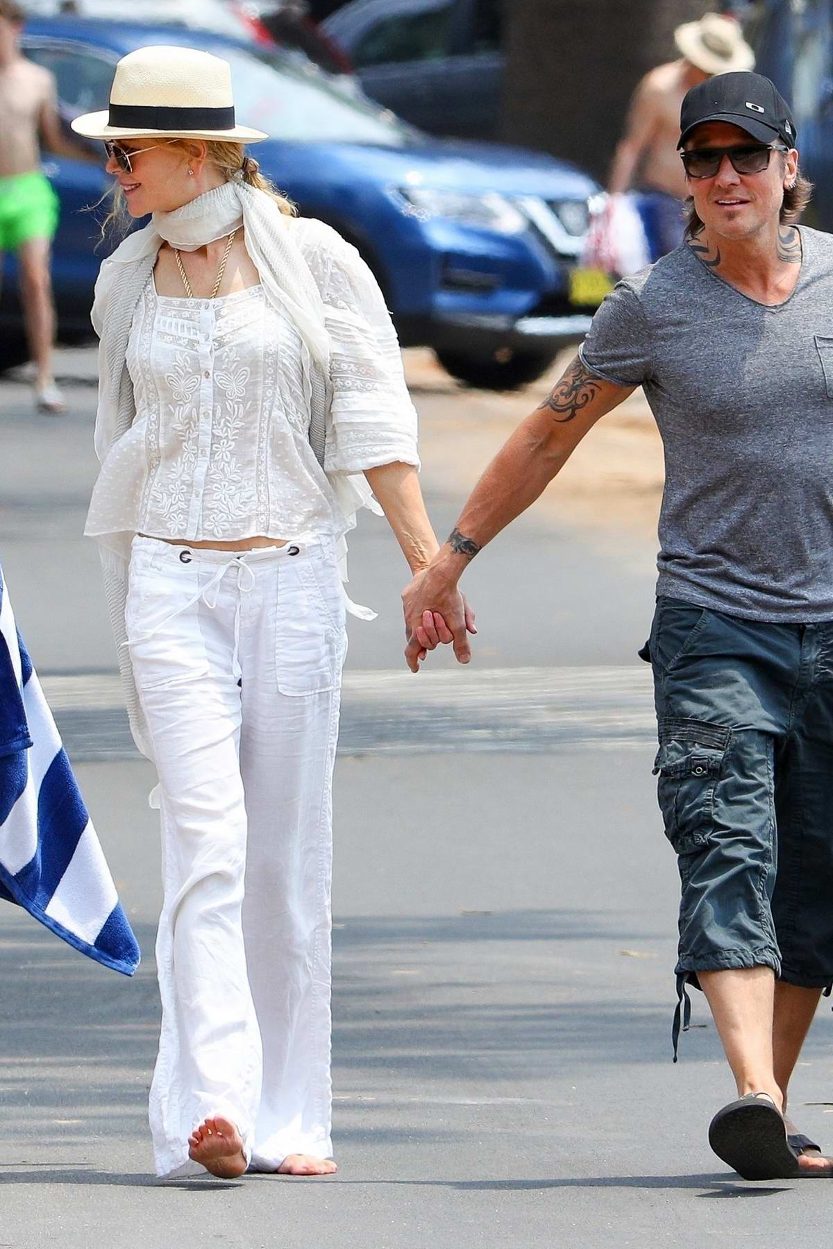 Nicole Kidman beams in all-white while starting her morning with coffee run alongside Keith Urban in Sydney, Australia