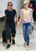 Nicole Kidman is all smiles as Keith Urban picks her up at the airport in Sydney, Australia