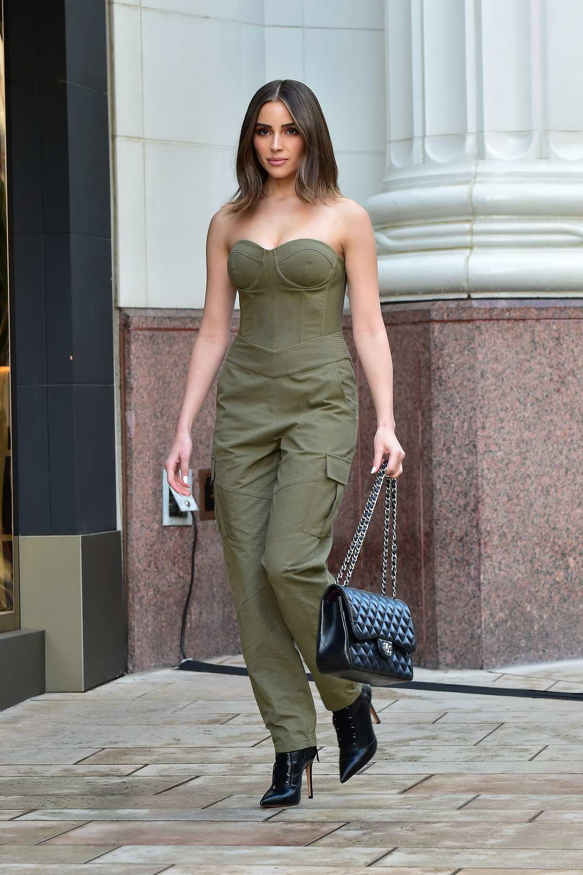 Olivia Culpo looks chic in an olive green jumpsuit while out shopping in Beverly Hills, Los Angeles