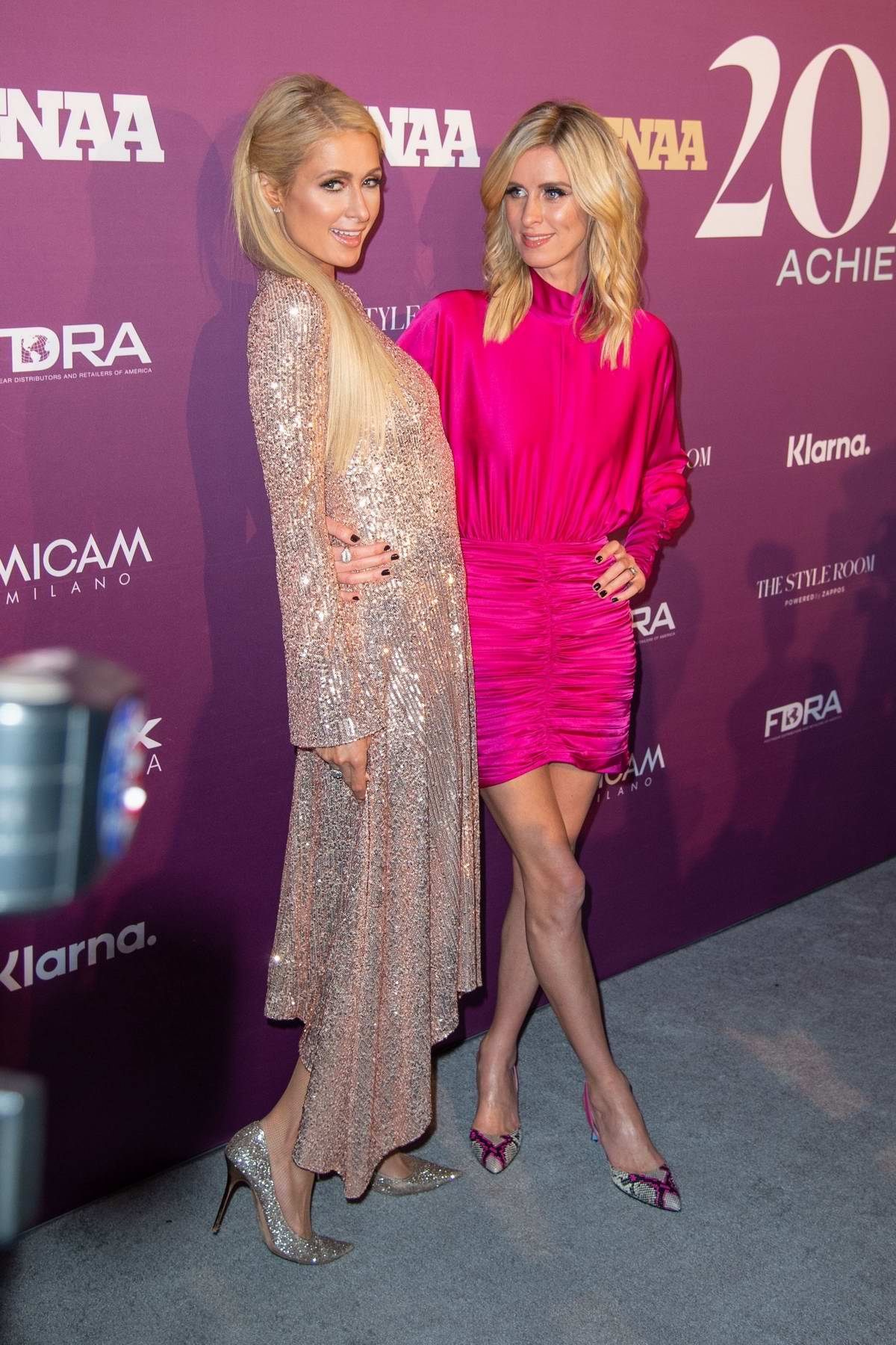 Paris and Nicky Hilton attend the 2019 Footwear News Achievement Awards at the IAC Building in New York City