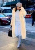Priyanka Chopra bundles up in a cream fur coat as she arrives back at her hotel in New York City